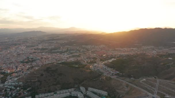 Malaga, Spain. A panorama shot by a drone over Malaga. City buildings and seaside view. Ships and port.