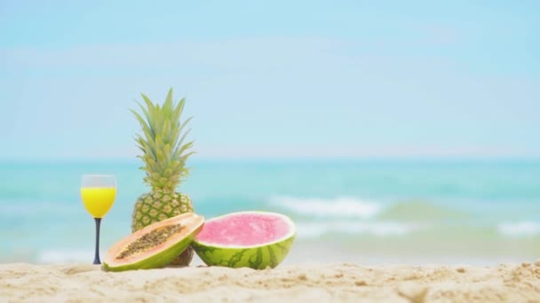 Fruits on the sea background. Beautiful fruit cocktail drink on beach.