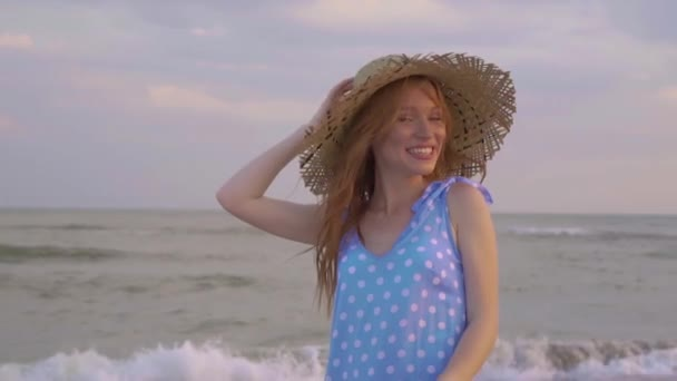 Portrait of Young Girl, charmingly Smiles to the Camera in Slow Motion. Has Straw Hat.