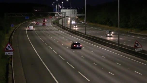 Watford, UK - July 2018: Evening fluent traffic on British motorway M1 during sunset