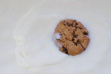 drop cookie into milk