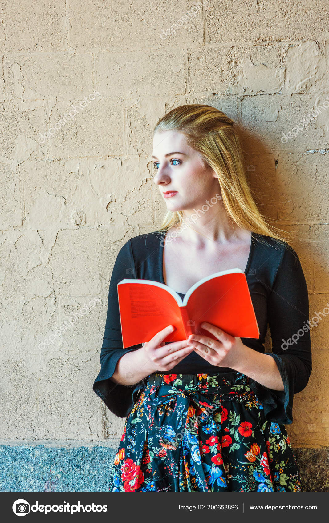 dcf6969bfa7 American teenage girl with long blonde hair, white skin, reading book  outside in New York, wearing black long sleeve low cut t shirt, patterned  skit, ...