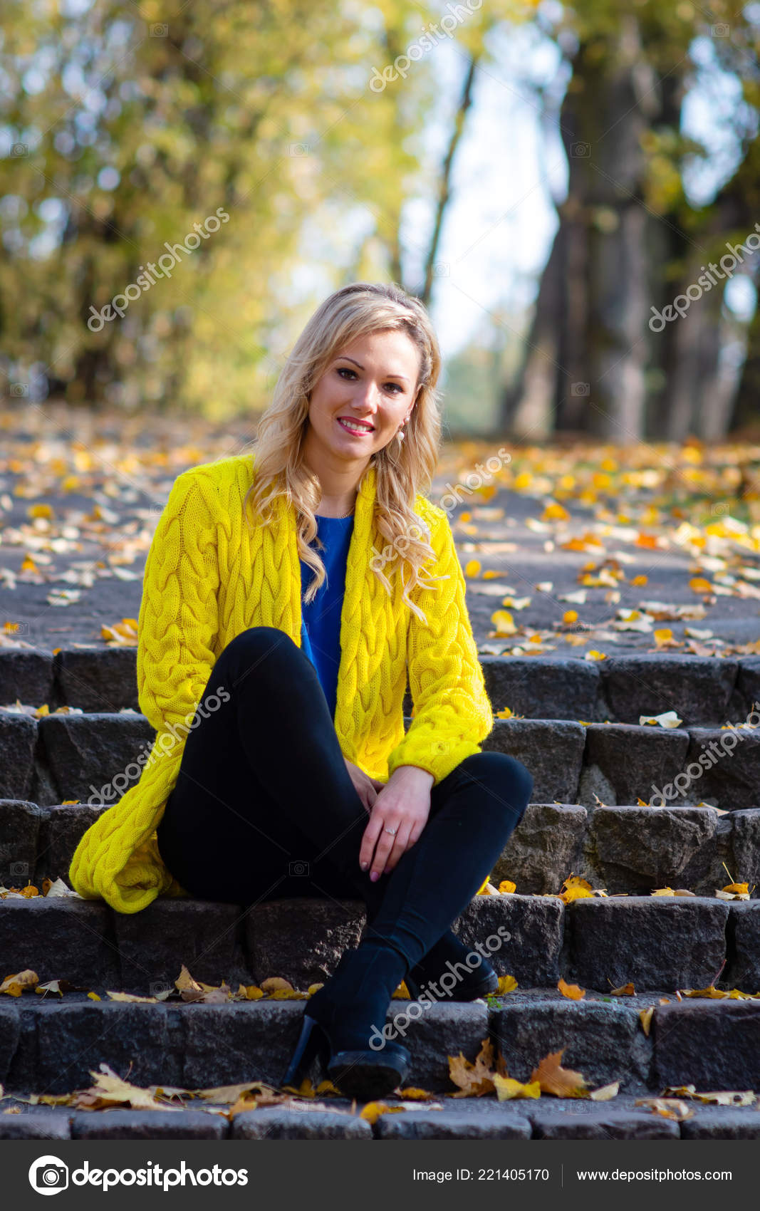 Young Beautiful Blonde Woman Sits Park Old Ladder Stock Photo