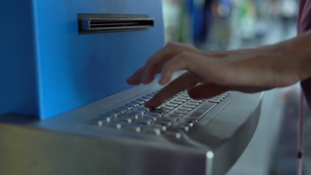 Hand of girl Filling her name on airport check-in kiosk keyboard to receive  a ticket in airport terminal