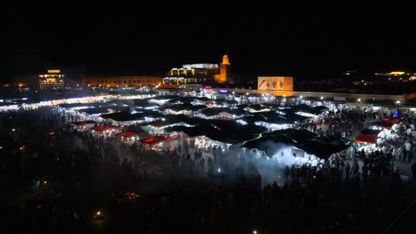 MOROCCO - MARRAKECH JAN 2019: Night view of Djemaa el Fna, a square and market place in Marrakech medina quarter