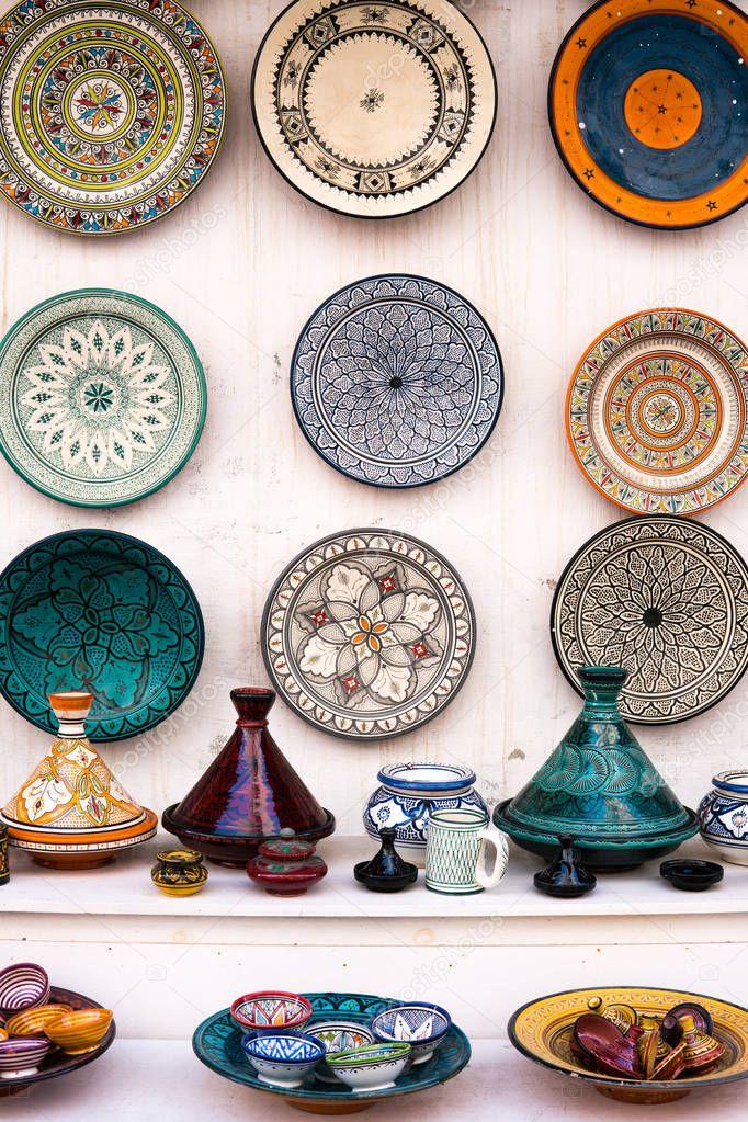 Colorful dish and tajine souvenirs for sale in a shop in Essaouira, Morocco