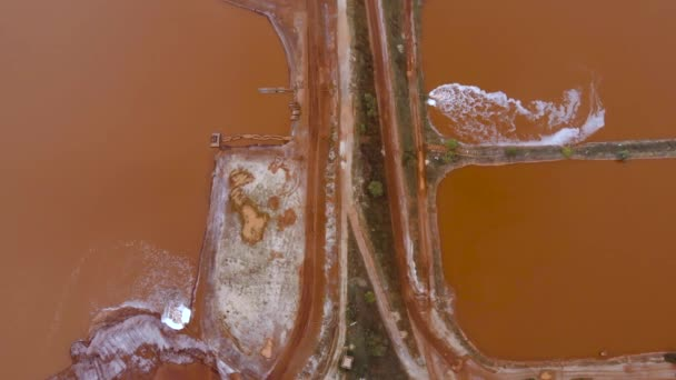 Aerial Bird eye Top View at Red Clay Pools With a Gateway Sluices Seethes: Spillway of a Clay Factory.