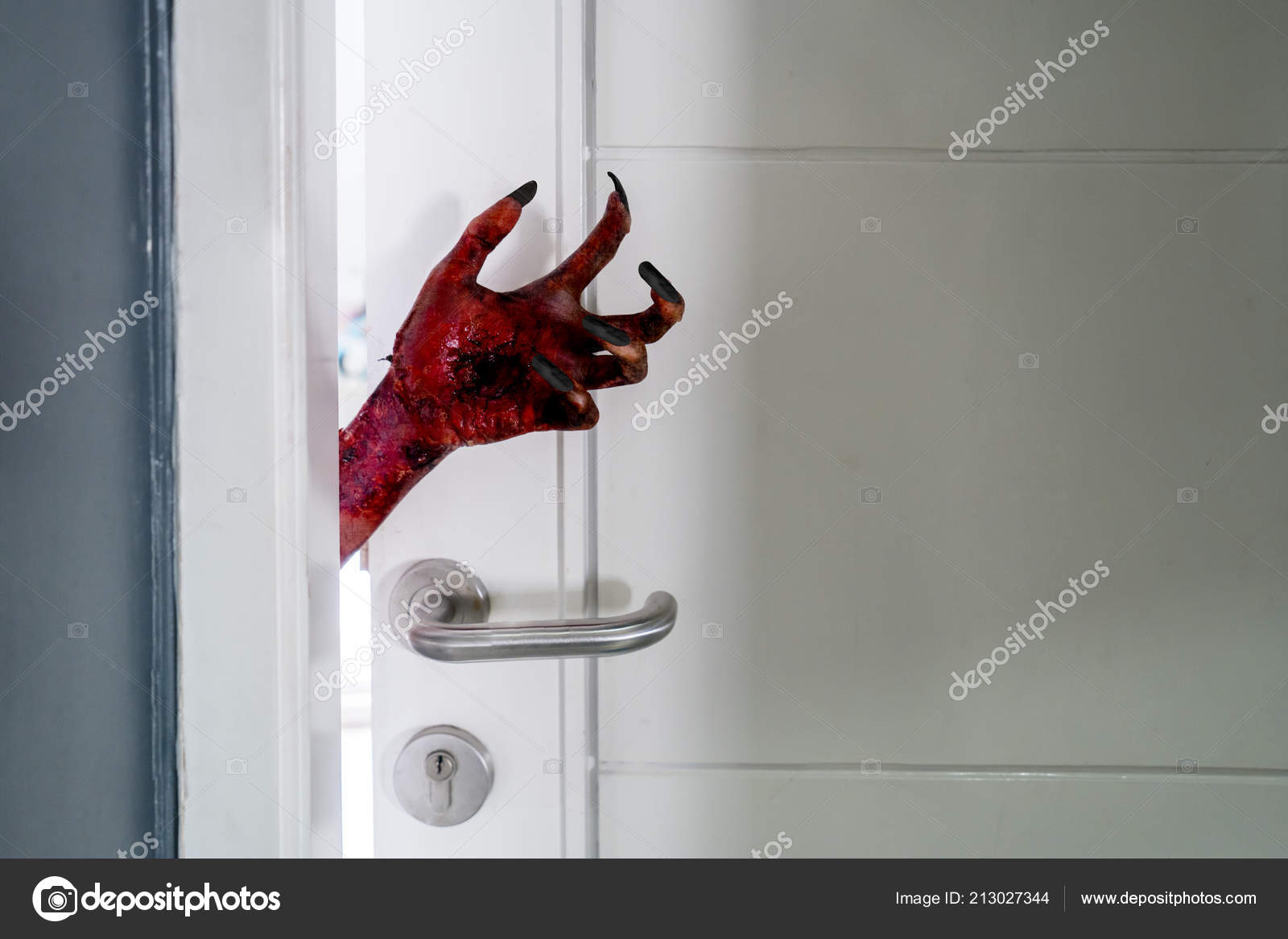 https://st4.depositphotos.com/1252160/21302/i/1600/depositphotos_213027344-stock-photo-closeup-scary-hand-emerging-open.jpg