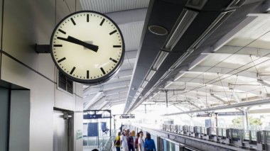 Clock with crowded passengers at the MRT station