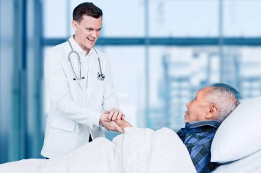 Caucasian male doctor comforting his elderly patient at consulting time in the hospital stock vector