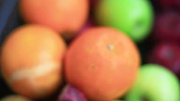 fruits, oranges are in a black basket