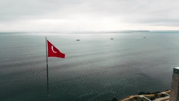 Aerial view of waving huge Turkish flag.