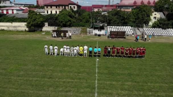 Lviv, Ukraine - June 28 2019 Two football teams listening anthems before football match. Aerial shot.