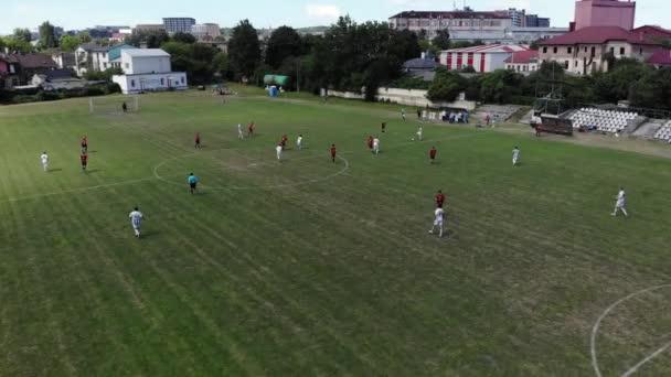 Lviv, Ukraine - June 28 2019 Two football teams playing match. Aerial shot.
