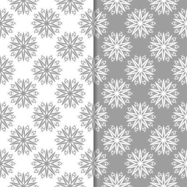 White and gray floral backgrounds. Set of seamless patterns for textile and wallpapers
