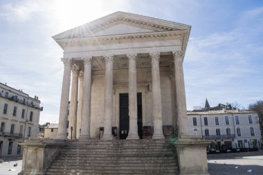 NIMES, FRANCE - CIRCA MARCH 2017: Unidentified people outside the Maison Carre Temple