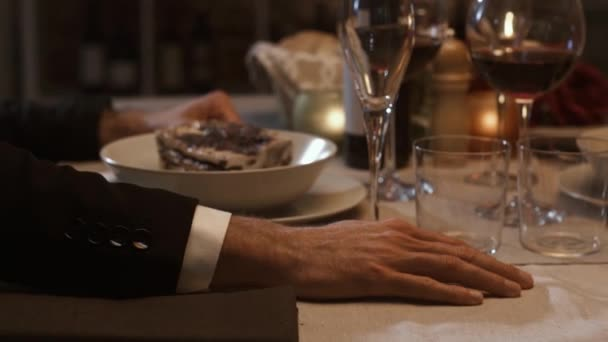 Romantic couple dining together and holding hands