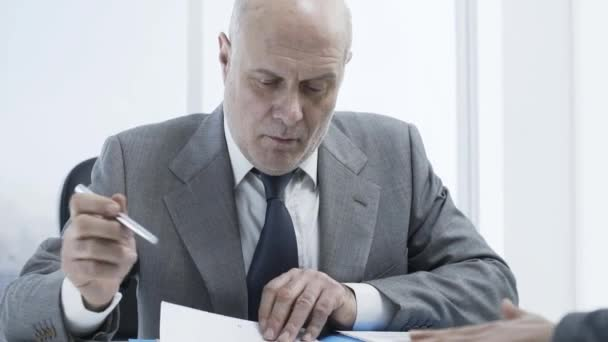 Corporate employer checking the candidates resume during a job interview, employment and business concept
