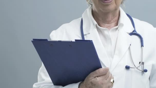 Smiling senior female doctor with stethoscope
