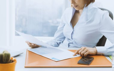 Business executive checking financial reports in the office