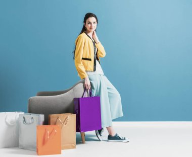 Shopaholic woman with lots of bags