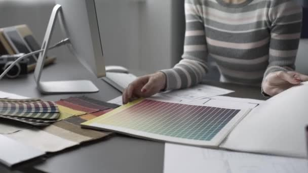 Creative designer searching swatches for her project