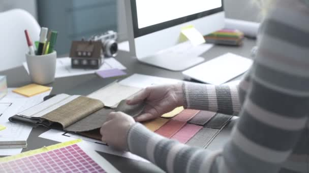 Interior designer checking fabric samples