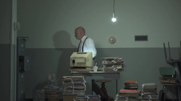 Disorganized businessman searching for files in his office