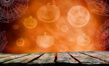 empty wooden table with Halloween pumpkins on background