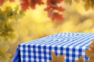 Empty table with blurred natural background