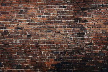Old weathered brick wall background