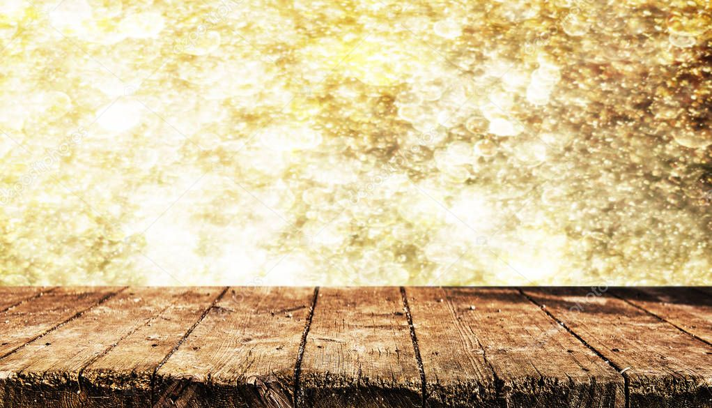 Empty wooden table with blurred natrural background