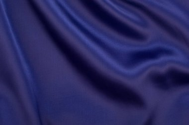 Navy silk fabric. Navy satin fabric as background.