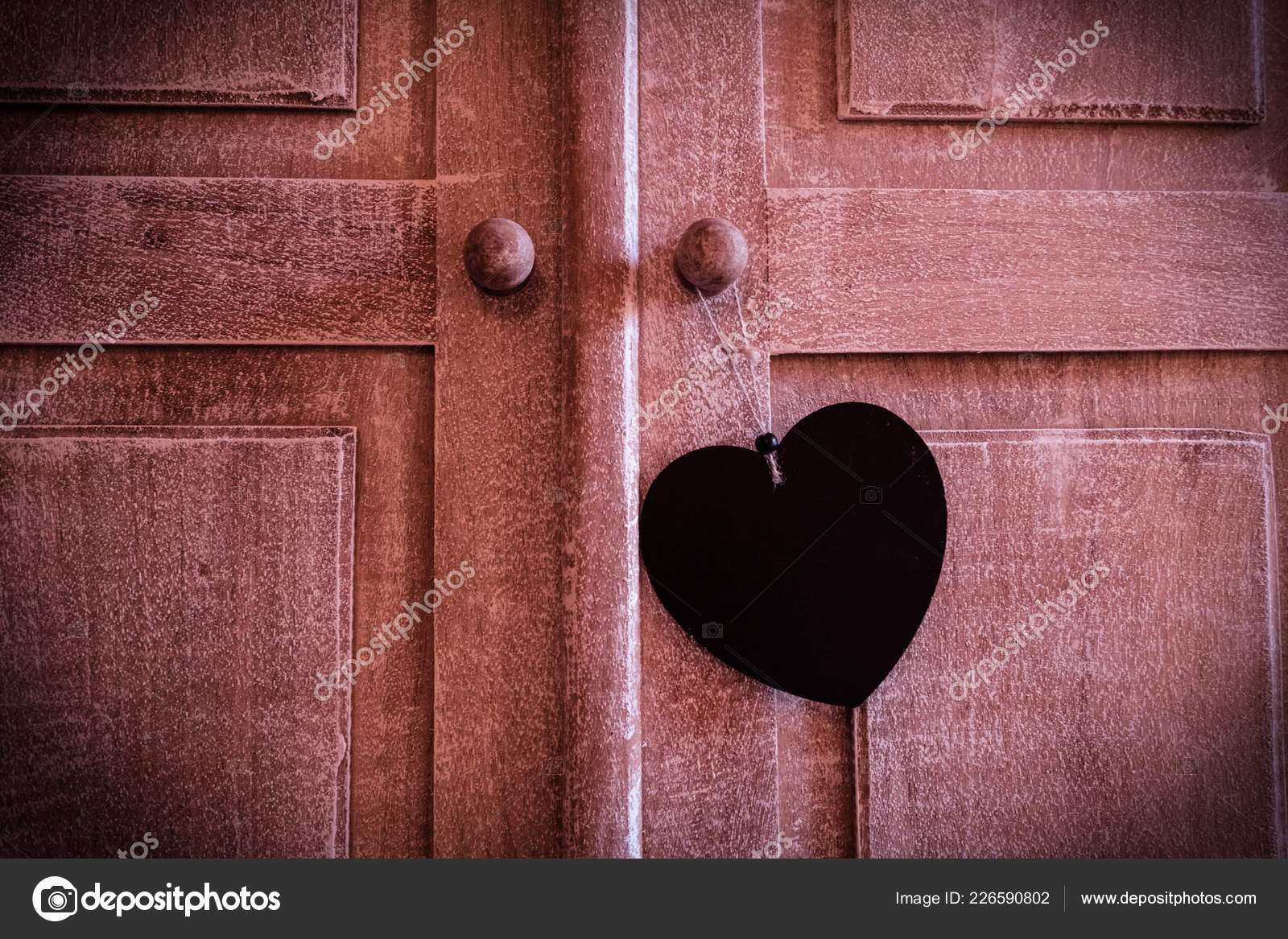 Blank Wood Heart Shaped Sign Hanger On Antique Rustic Wooden Door