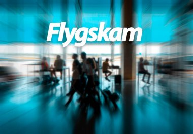 Flyskam word with airport passengers on the background.