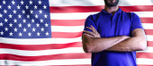 Photo Torso of a man Young man with arms crossed against united states national flag