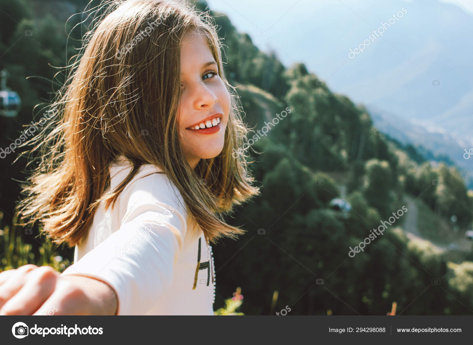 Smiling Tween Girl Reaches Out To Camera Follow Me On Background Of Beautiful Mountains Family Travel Concept Stock Photo Image By C Galinazhigalova 294298088