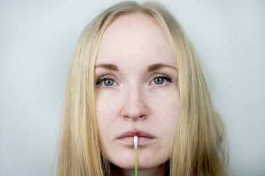 Beautiful young woman, lips infected with herpes virus. The concept of treatment of the herpes virus