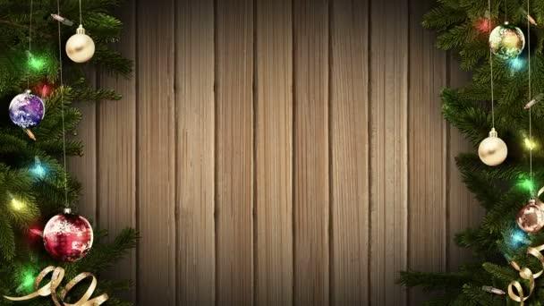Slavnostní vánoční rámeček na staré rustikální dřevěný stůl vám pomůže vytvořit báječné a magickou atmosféru pro váš materiál. Vánoční rámeček s větvemi jedlí, věnec, vánoční koule na staré rustikální dřevěný stůl, pohled shora. smyčkou