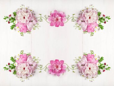 Bouquet of beautiful pink peonies on white wooden background. Top view. Copy space