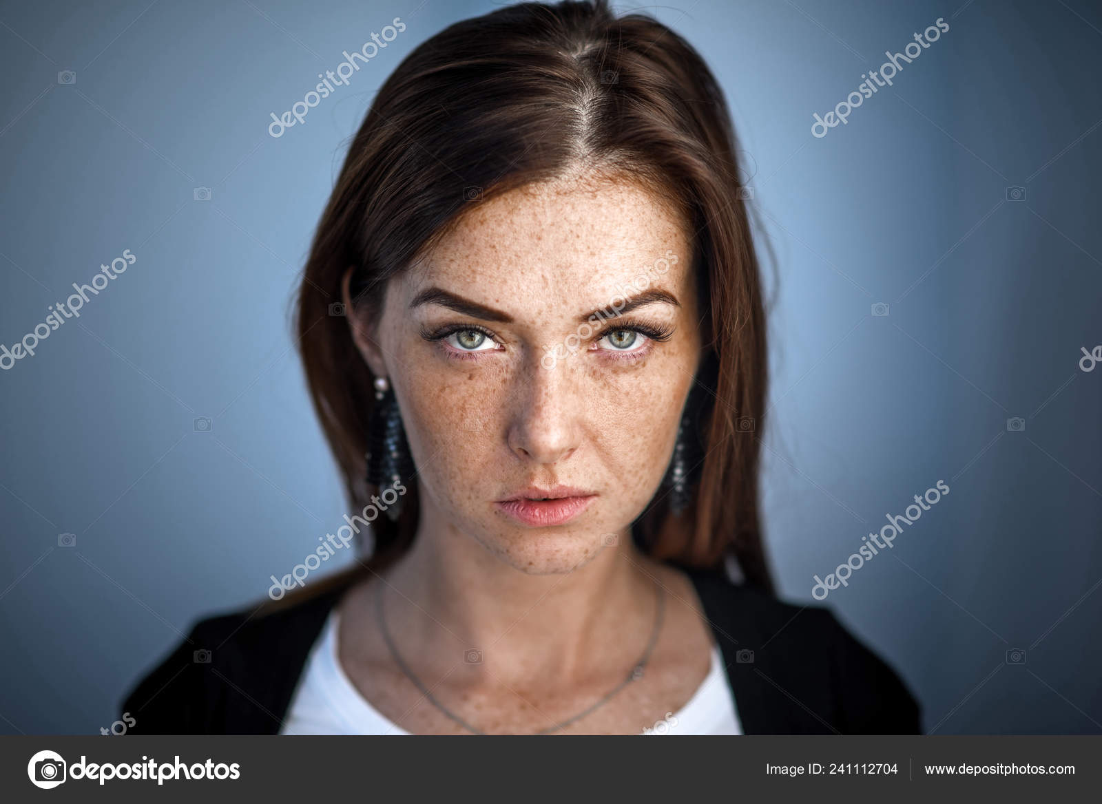 Cute Redhead Girl Looks Into The Camera Modern Girl In An Urban Environment Freckles Face Stock Photo C Cinematheart Gmail Com 241112704