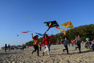 Participant flying colorful kites on the Kite Festival event in Coxs Bazar beach in Bangladesh. On February 01, 2019'National Kite Festival 2019' organized by Bangladesh Kite Federation in the beach city of Cox's Bazar, Bangladesh.