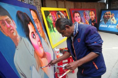 Bangladeshi artist drawing film banner at Old Town in Dhaka City, Bangladesh, on January 30, 2018. Film banner painting is one of the extinct arts works in Bangladesh.