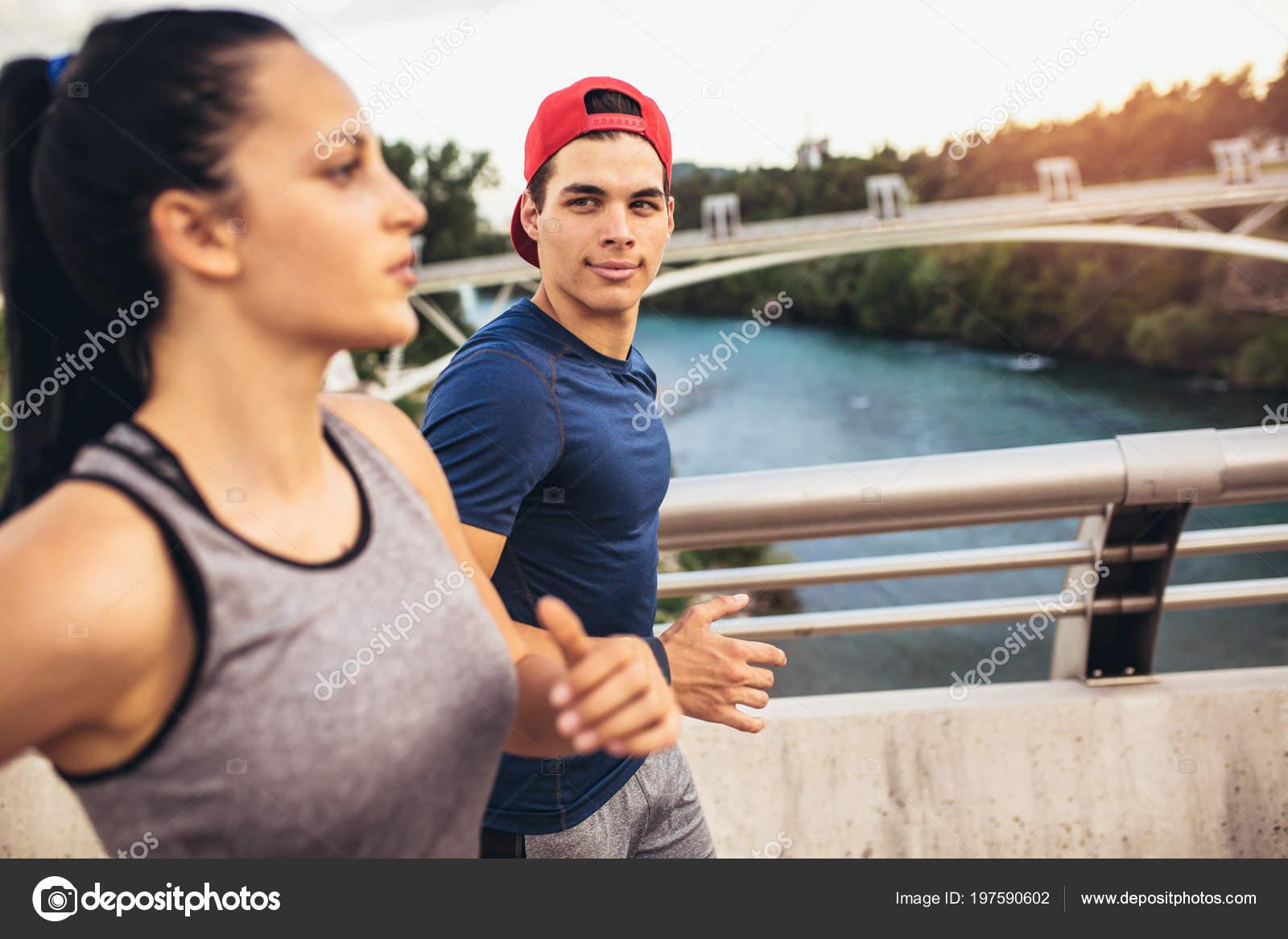 Happy Couple Running Bridge Healthy Lifestyle Stock Photo