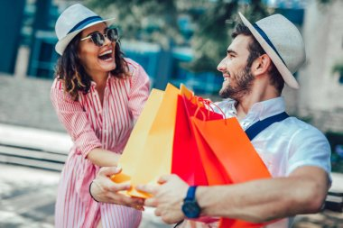 Couple having fun outdoor while doing shopping together