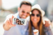 Fotografie Couple taking selfie in city on vacation