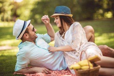 Beautiful couple enjoying picnic time outdoor
