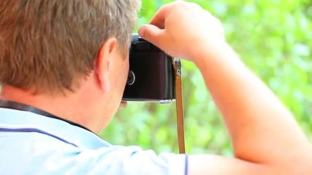 Starý fotoaparát fotograf natočit záběry přírody