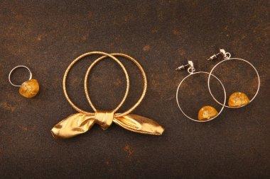 silver earrings murano glass ring asphalt background