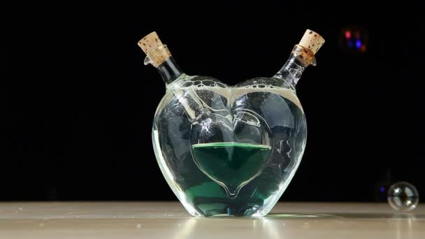 soap glass green heart bubbles wooden table dark background nobody hd footage